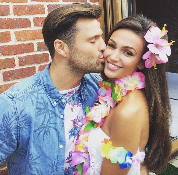 Mark Wright kisses wife Michelle Keegan at their Hawaiian-themed party over the weekend - 25 July 2015.