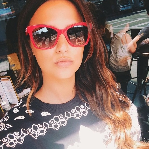Lucy Watson posts selfie to Instagram, wearing tousled waves and red sunglasses 30th July 2015