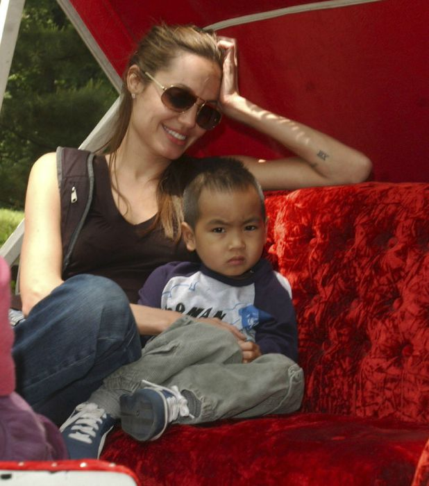 ANGELINA JOLIE and her son MADDOX on the carousel in Central Park and then on a horse carriage ride through Central Park and then walking down the street back to the hotel in New York City