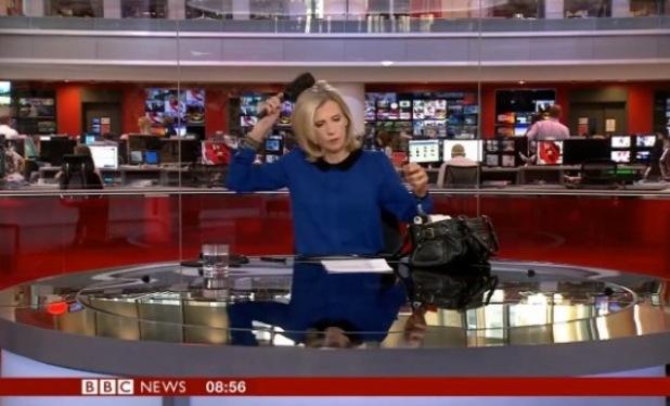 BBC news correspondent Carole Walker caught brushing hair live on air - 4 August 2015.