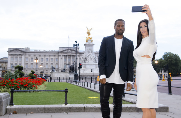 Kim Kardashian West and Kanye West wax figures by Madame Taussauds take selfies in London, 6th August 2015