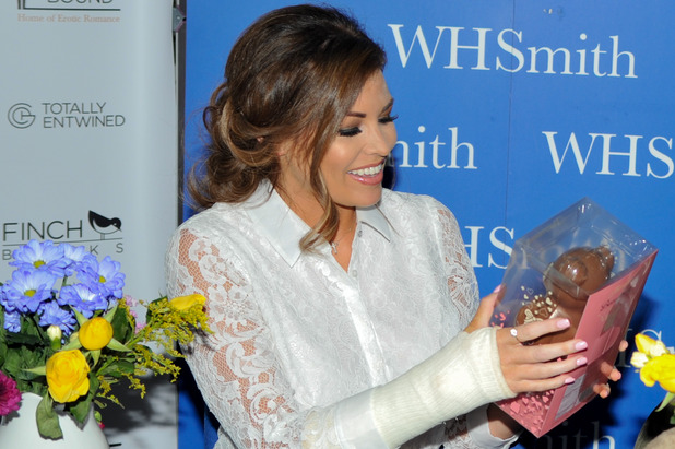 Jessica Wright, wearing a cast on her right forearm, signs copies of her book 'Sparkling Stiletos' at WHSmith in Birmingham City Centre, 7th August