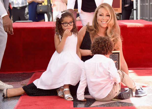 Singer Mariah Carey with Monroe Cannon and Moroccan Cannon, is honored with Star on The Hollywood Walk of Fame on August 5, 2015 in Hollywood, California.