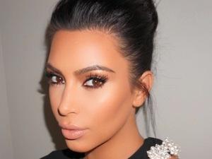 Kim Kardashian posts hair selfie to Instagram, chignon bun 13th August 2015