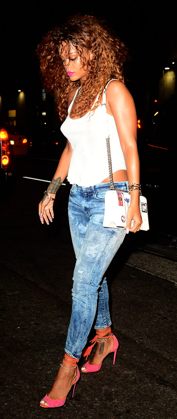 Rihanna out and about in New York wearing jeans and heels 12th August 2015