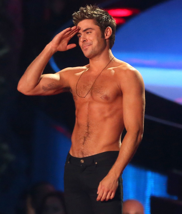 Zac Efron accepts the Best Shirtless Performance award at the 2014 MTV Movie Awards - 13 April 2014.