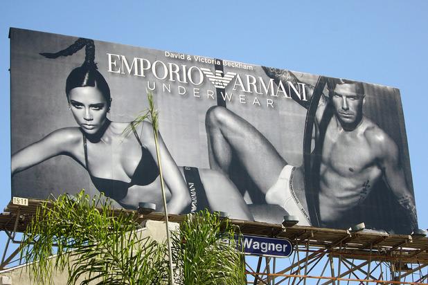 Victoria Beckham and David Beckham appear on a billboard showing their Emporio Armani underwear campaign, 2009