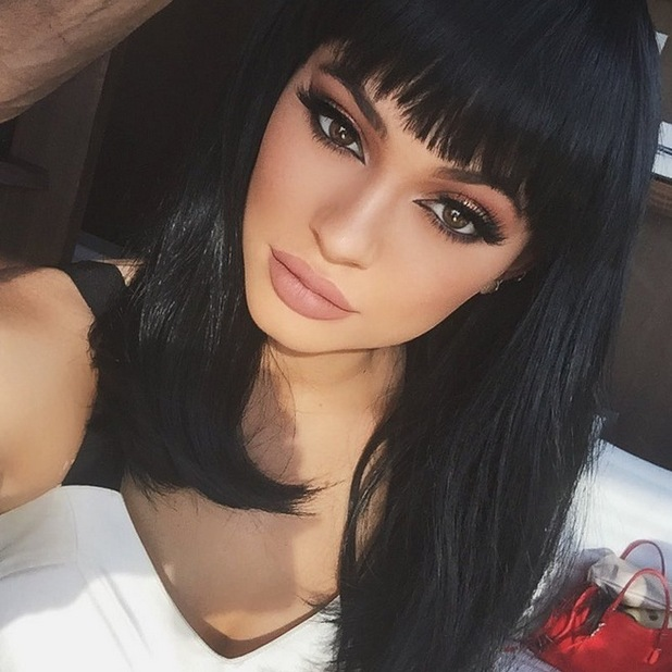 Kylie Jenner shows off a new hairstyle in a black wig, 18th August 2015