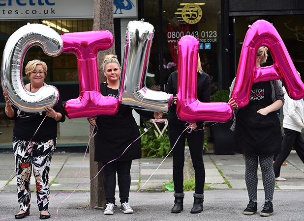 Well wishers gather on the street with balloons spelling 'Cilla' on August 20, 2015 in Liverpool, England. Singer and TV host Cilla Black died on the 1st August at her home in Spain after a head injury caused by a fall.