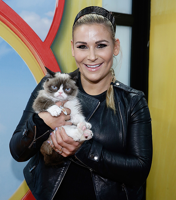 Natalya Neidhart presents Grumpy Cat to the press during Friskies Create & Taste Kitchen Press Preview on August 19, 2015 in New York City. (Photo by John Lamparski/Getty Images)