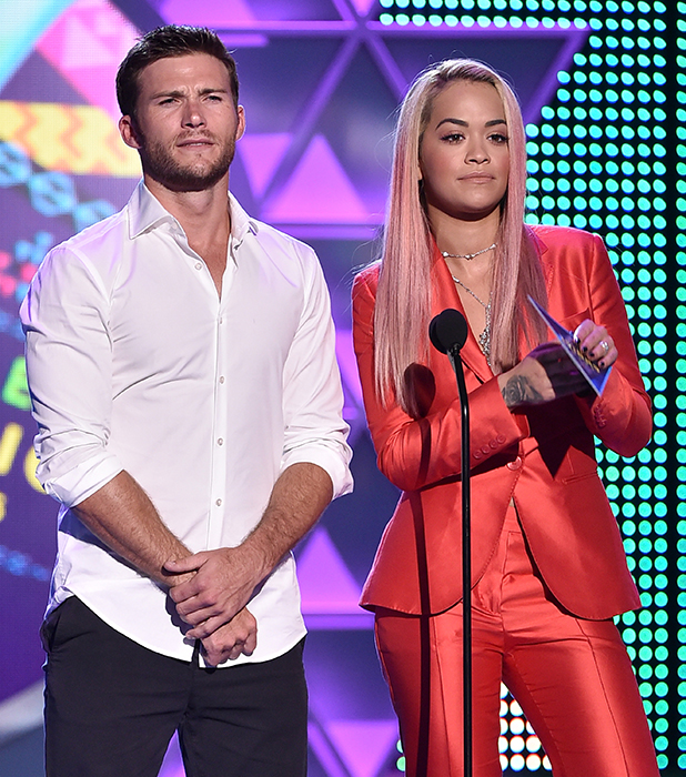 Scott Eastwood (L) and actress/singer Rita Ora speak onstage during the Teen Choice Awards 2015 at the USC Galen Center on August 16, 2015 in Los Angeles, California. (Photo by Kevin Winter/Getty Images)