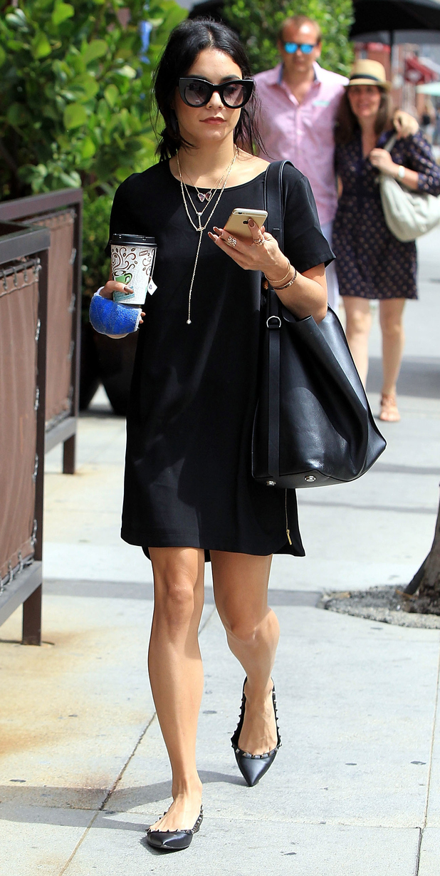 Vanessa Hudgens wears hand cast while out and about in L.A 26th August 2015