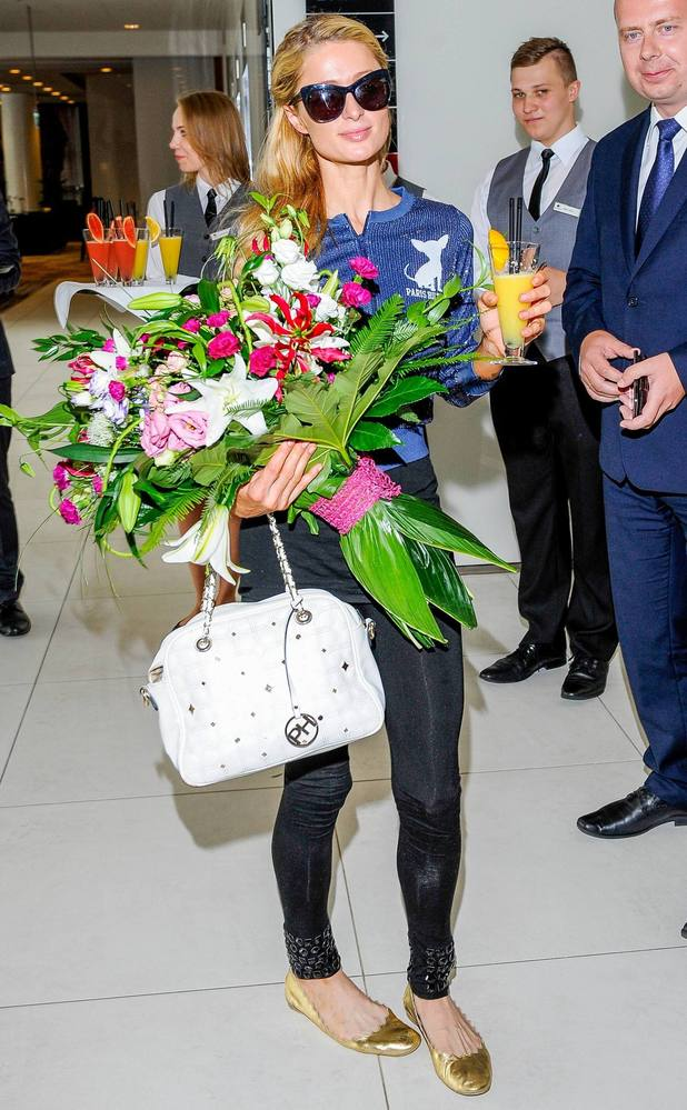 Paris Hilton is greeted with flowers as she arrives at Warsaw Chopin Airport, 28th August 2015