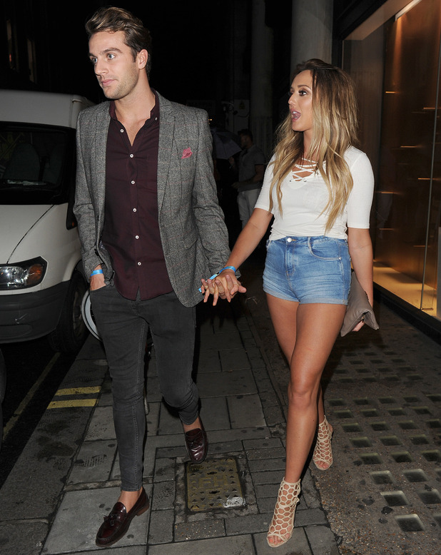 Charlotte Crosby and Max Morley hand-in-hand after attending Jeans For Genes party, London 2 September