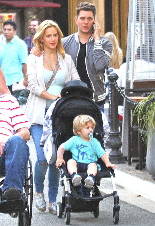 Michael Bublé chats on his mobile phone while out shopping with his wife Luisana and son Noah at The Grove in Hollywood - 4 Sep 2015