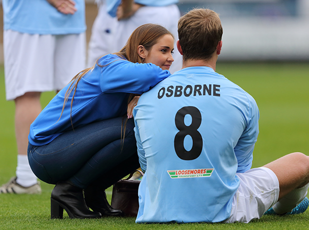 Actress Jacqueline Jossa talks to her partner Dan Osborne during a charity football match in aid of PDSA at Greenhous Meadow, home of Shrewsbury Town Football Club, on August 30, 2015 in Shrewsbury, United Kingdom.