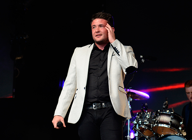 Shane Richie Junior Band performs on the main stage at Manchester Pride's The Big Weekend. Jessy Nelson and Jake Roche watch from a VIP Area.