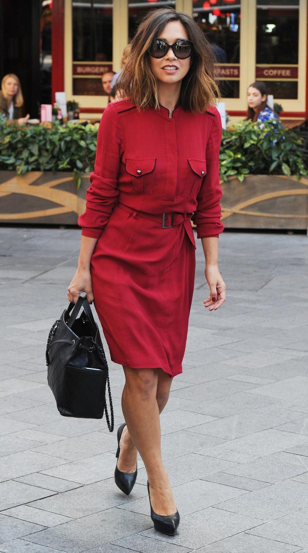 Myleene Klass wears crimson coloured military dress to work in London, 10th September 2015