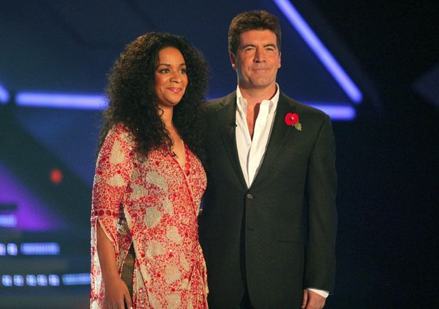 X Factor star Rowetta Satchell and judge Simon Cowell - 6 Nov 2004