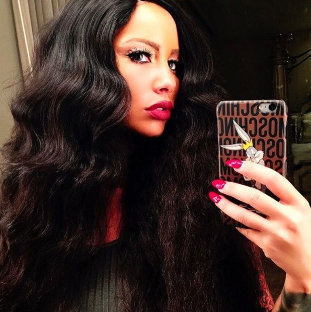 Amber Rose gets a full head of hair extensions and shares picture to Instagram, 15th September 2015