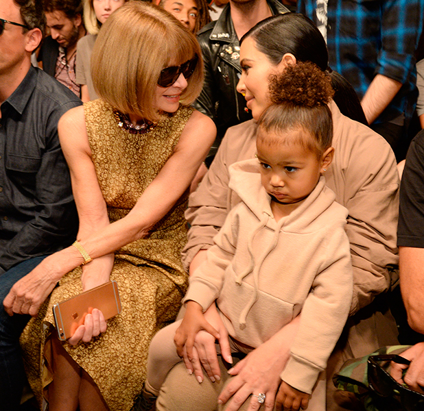 Anna Wintour, Kim Kardashian West and North West attend Kanye West Yeezy Season 2 during New York Fashion Week at Skylight Modern on September 16, 2015 in New York City. (Photo by Kevin Mazur/Getty Images for Kanye West Yeezy)