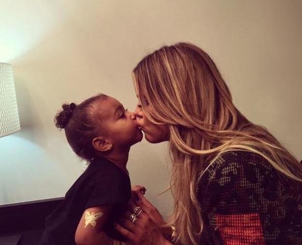 Khloe Kardashian kisses niece North West, 26 September 2015