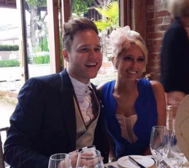 Olly Murs and girlfriend Francesca Thomas attend a wedding together.