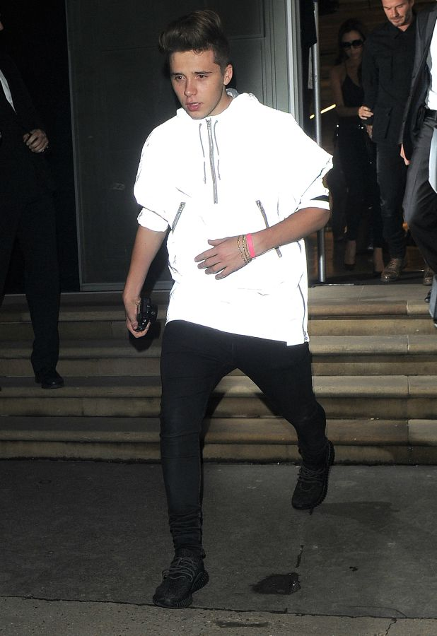 Brooklyn Beckham pictured leaving mum Victoria's flagship London store at 2am 22 Sep 2015