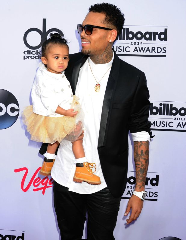 Chris Brown and daughter arrive at the 2015 Billboard Music Awards at the MGM Grand Garden Arena on May 17, 2015 in Las Vegas, Nevada. (Photo by Jeffrey Mayer/WireImage)