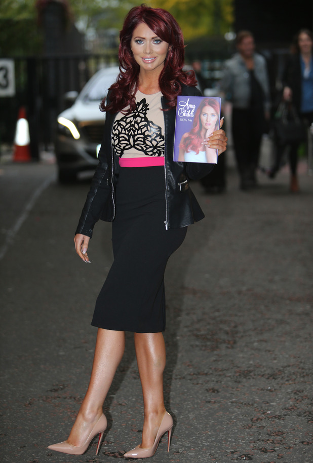 Amy Childs outside ITV Studios, holding a copy of her new book '100% Me'. 7th October 2015