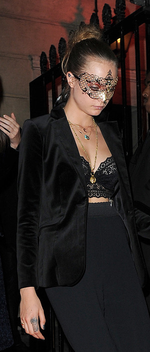 Cara Delevingne with Kendall Jenner at Eva Cavalli's birthday party in London wearing lip ring, 12th October 2015