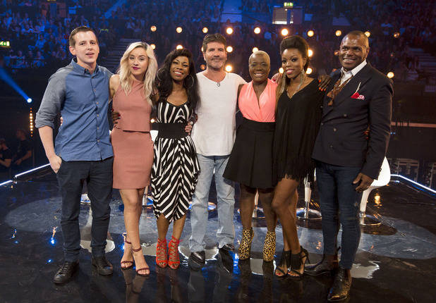 X Factor: Simon Cowell and his final six groups at the Six Chair Challenge. 18 October 2015.