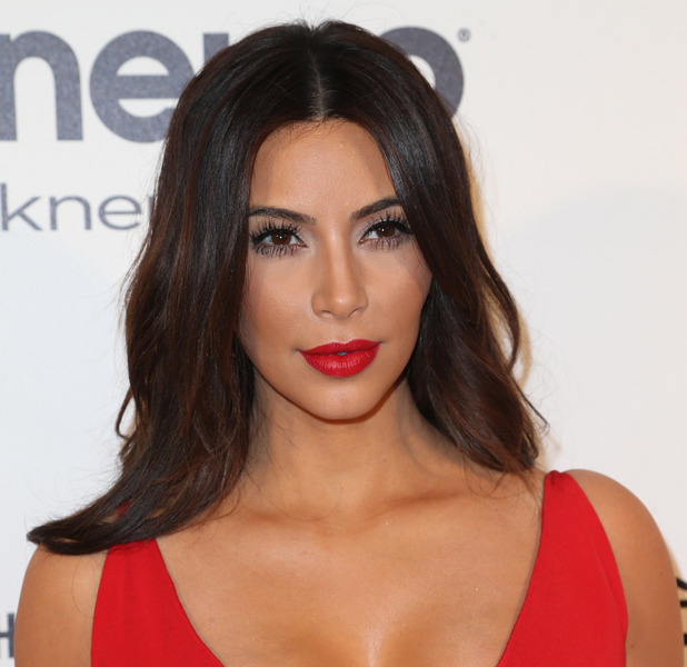 Kim Kardashian wears red lip and red dress to the Oscars, 21st October 2015