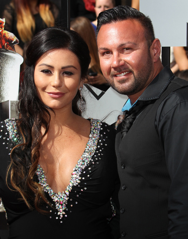 Jenni 'Jwoww' Farley and Roger Mathews at the 23rd Annual MTV Movie Awards at the Nokia Theatre - 13 April 2014.