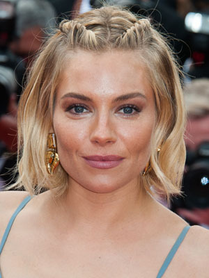 Sienna Miller wearing plaits at Cannes on 25 May 2015