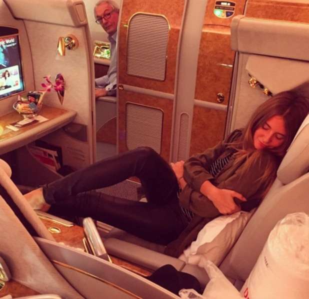 Millie Mackintosh snuggles up in-flight on the way to the Melbourne Cup, 28 October 2015