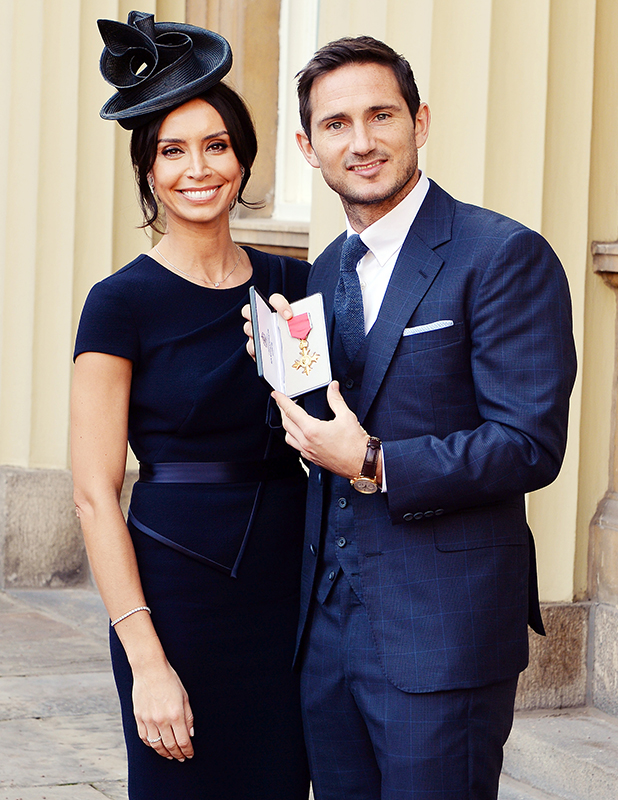 Frank Lampard poses with partner Christine Bleakley as he holds his Officer of Order of the British Empire (OBE) medal, after it was presented to him by the Duke of Cambridge, at an Investiture ceremony at Buckingham Palace on October 27, 2015 in London, United Kingdom. (John Stillwell - WPA Pool/Getty Images)