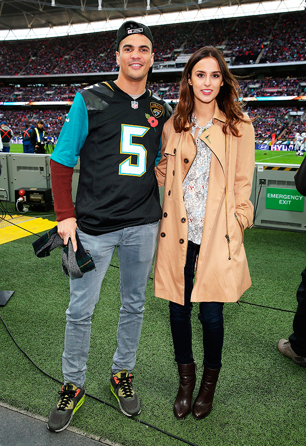 Lucy Watson (L) and James Dunmore attend the annual NFL International Series as the Jacksonville Jaguars compete against the Buffalo Bills at Wembley Stadium on October 25, 2015 in London, England