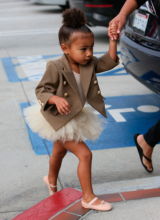 North West seen going to ballet class with her nanny 28 Oct 2015