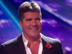 X Factor: Anton Stephans accidentally headbutted Simon during the results show. 1 November 2015.