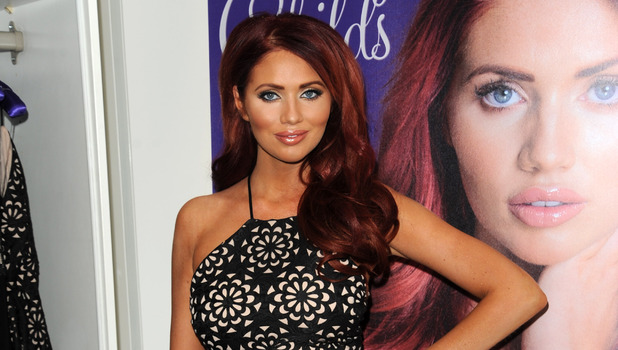 Amy Childs promotes her new book '100% Me' at her boutique in Brentwood. 8 October 2015.