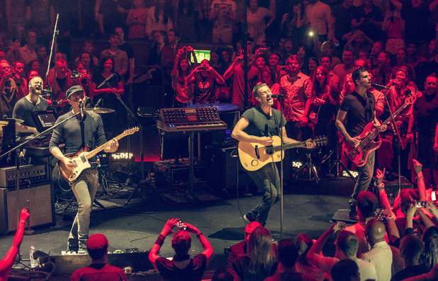 Coldplay performing live in concert at the Royal Albert Hall - 2 July 2014.