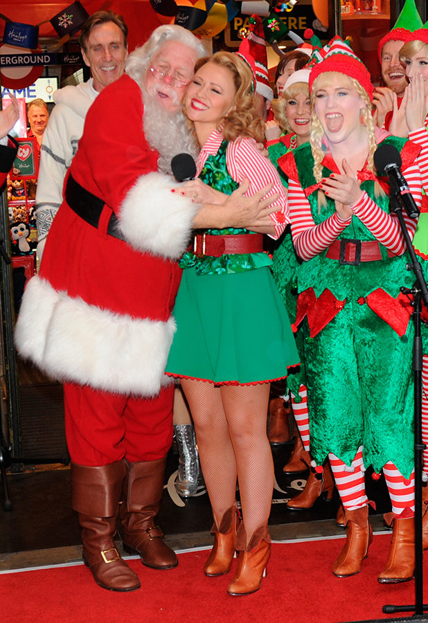 Elf the musical cast attend children's toy store to unveil their Christmas window and perform songs from the show, ahead of the musical's opening Kimberley Walsh
