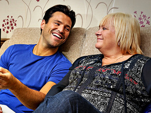 Mark Wright serves tea and yoghurt to lucky competition winner