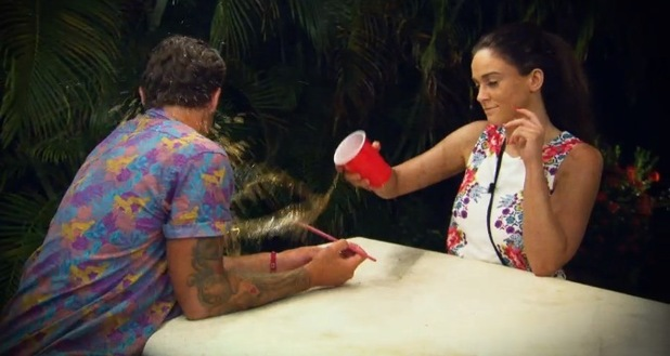 Vicky Pattison throws a drink over Stephen Bear during a row on Ex On The Beach, 2015