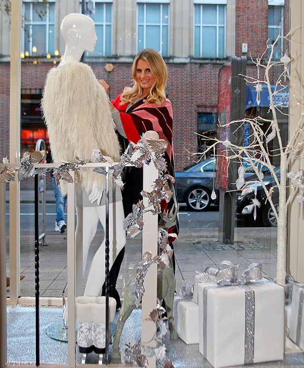 TOWIE star Danielle Armstrong putting up xmas decorations at Danni's Boutique in Hornchurch,Essex