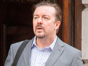 Ricky Gervais, starring as David Brent, films a scene from his upcoming film 'Life on the Road'. In this scene David Brent is trying to sell his album entitled 'Foregone Conclusion' on the streets of Soho.