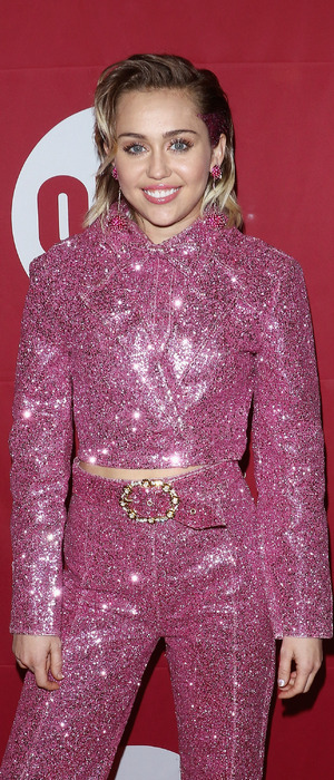 Miley Cyrus attends the ONE & RED event in New York in glittery pink suit, 2nd December 2015