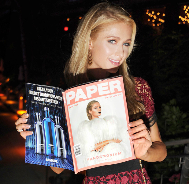 Paris Hilton reading over Paper magazine after becoming their newest cover star, 2nd December 2015