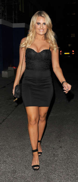 Danielle Armstrong in black dress seen at Turntable Bar in Holborn, London, 9th December 2015